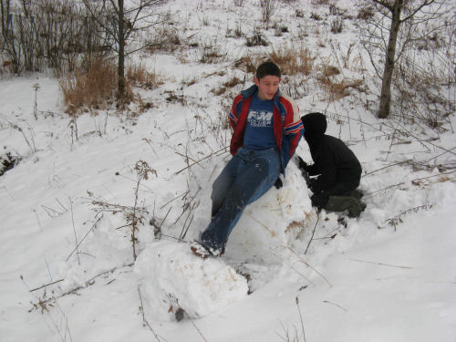 Relaxing on the remains of Snow Boulder #4. BTW: Justin does normally wear snowpants.