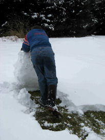 Justin rolls the snow ball