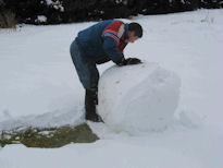 Justin stopping to inspect snow ball (or maybe pat it down)